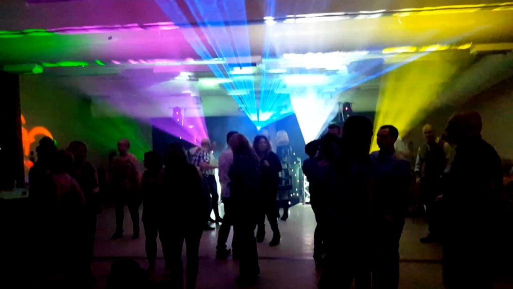 Purple, blue and yellow laser effects at mobile disco