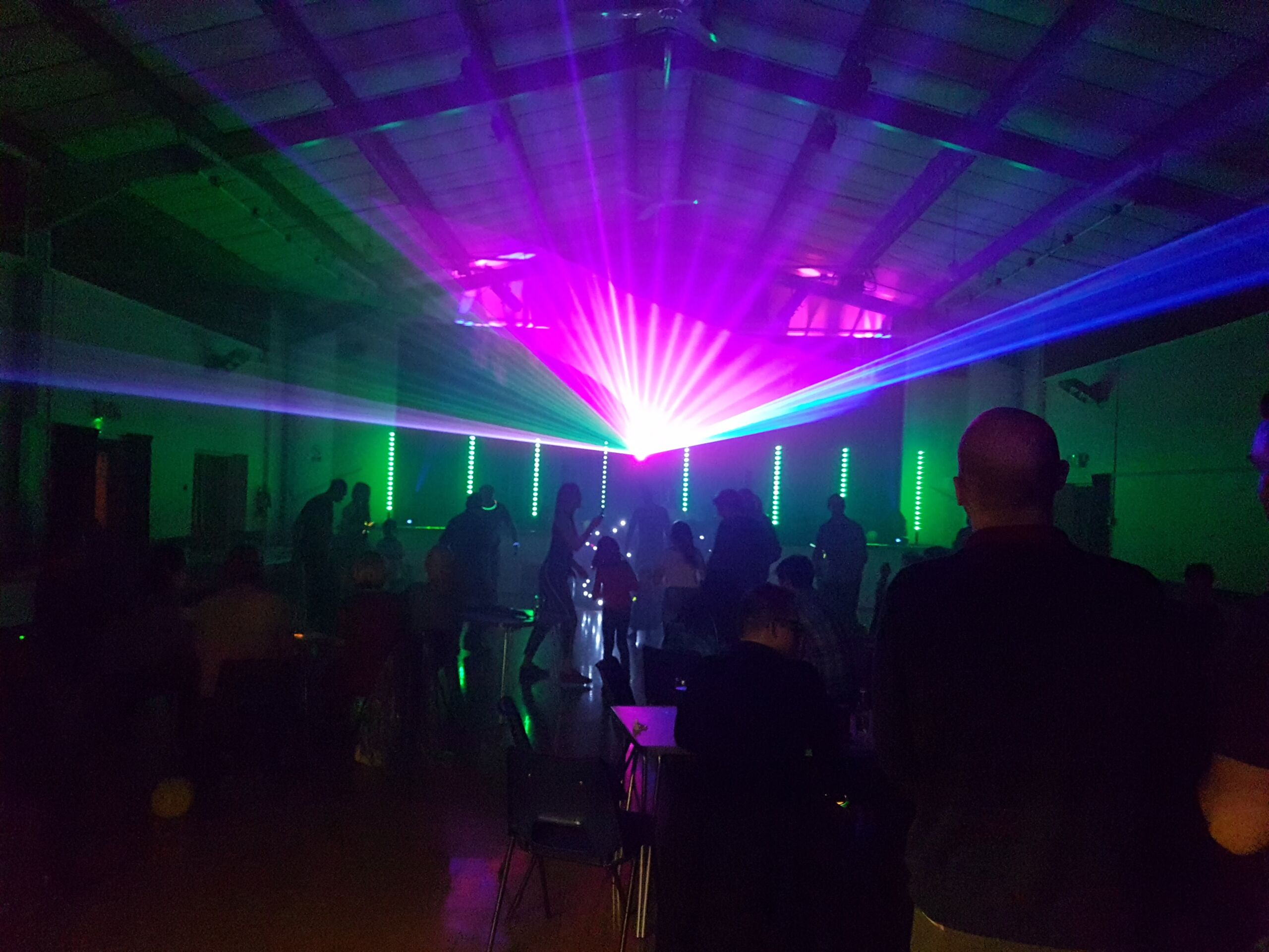 Pink and Blue laser lighting at a mobile disco