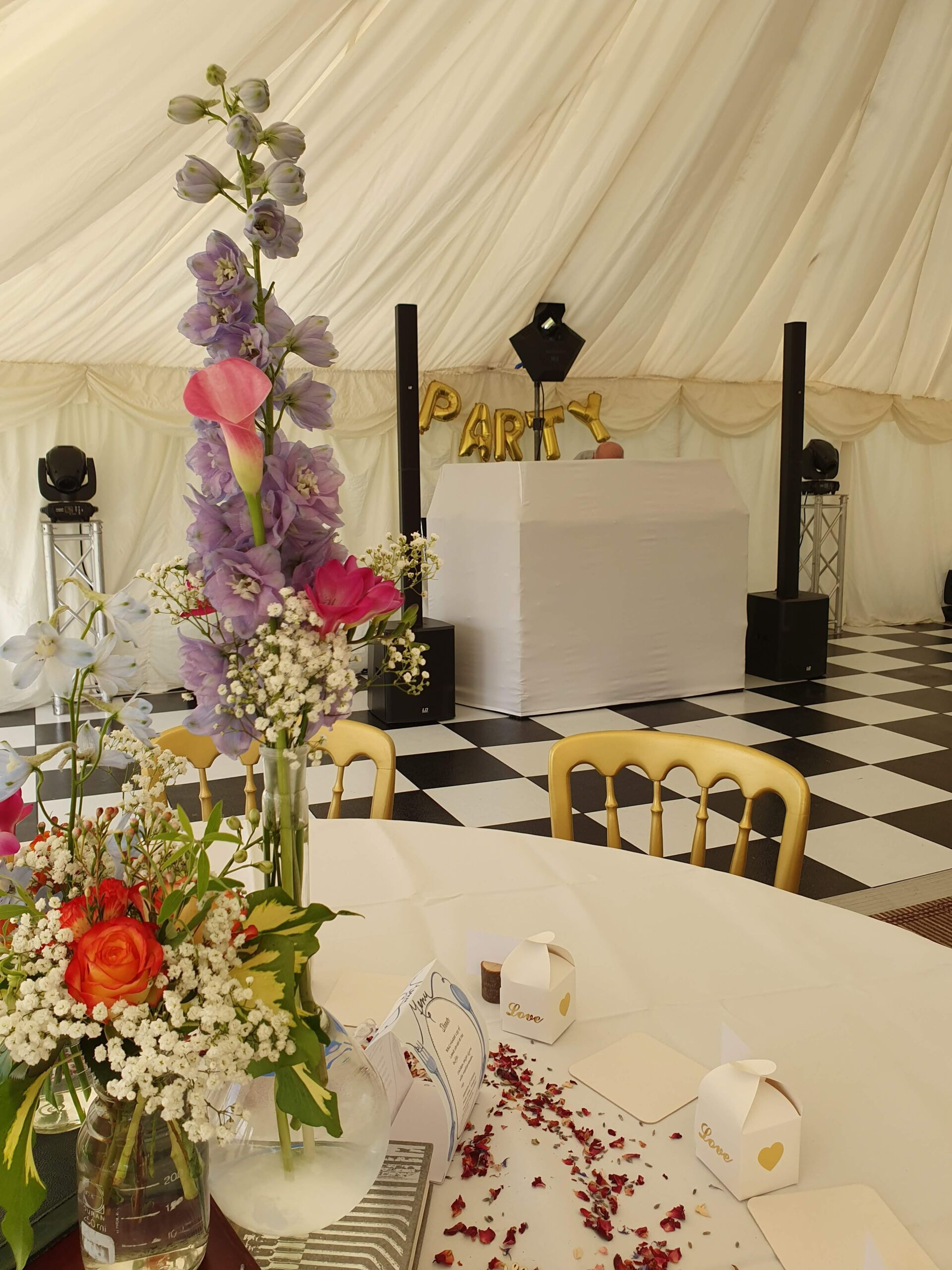 White mobile disco set up with gold Party balloons