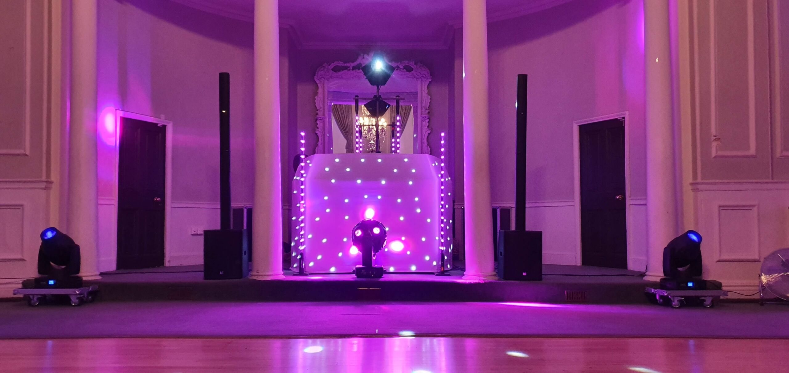 Mobile Disco set up with pink uplighting at The Atheneum in Bury St Edmunds, Suffolk