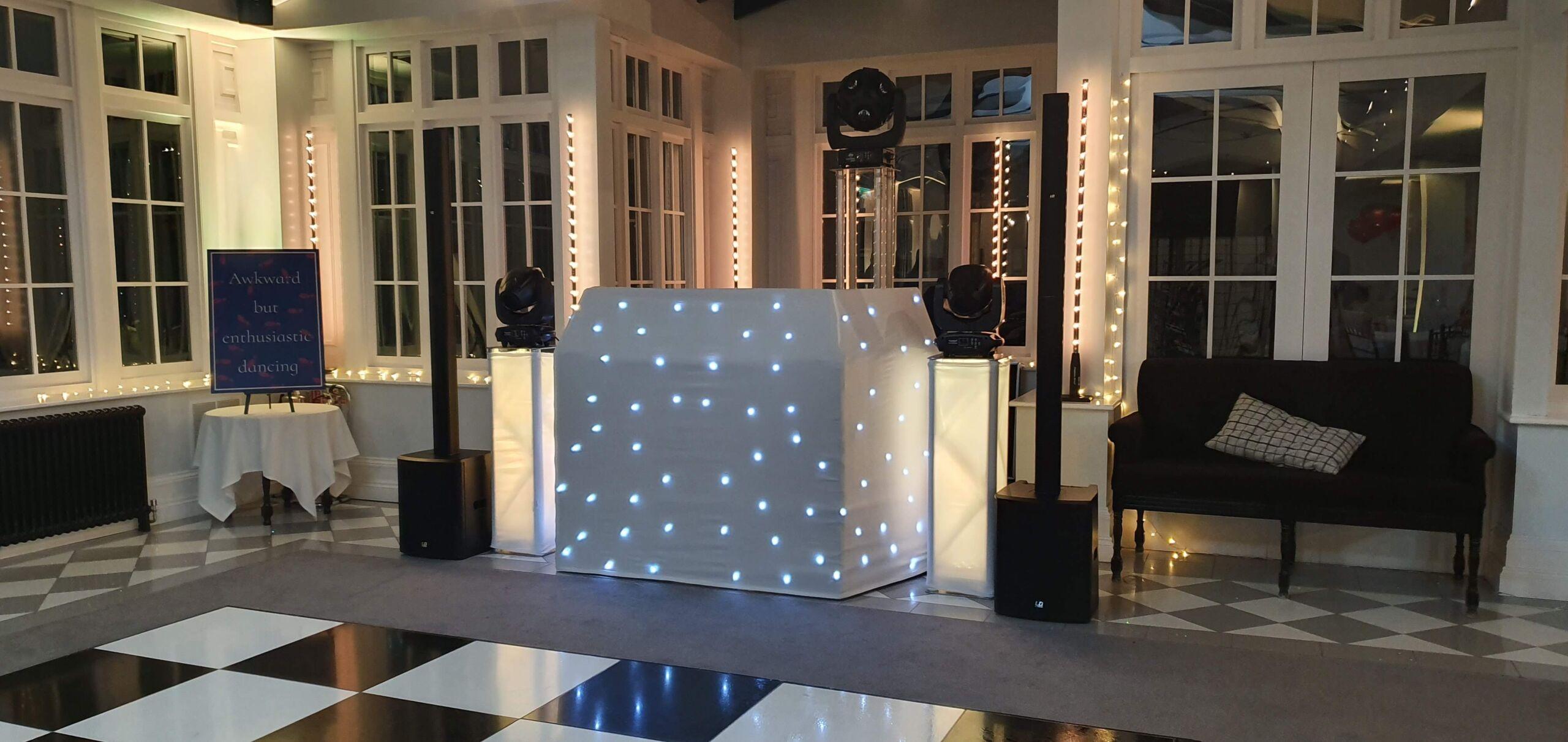 Wedding disco at Swynford Manor, Suffolk, Cambridgeshire with white starlit DJ booth