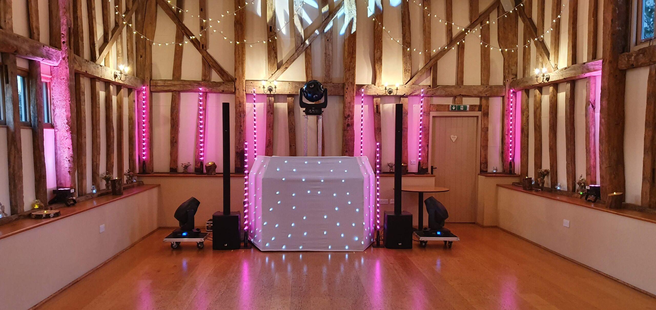 Garden Barn wedding disco with pink uplighting