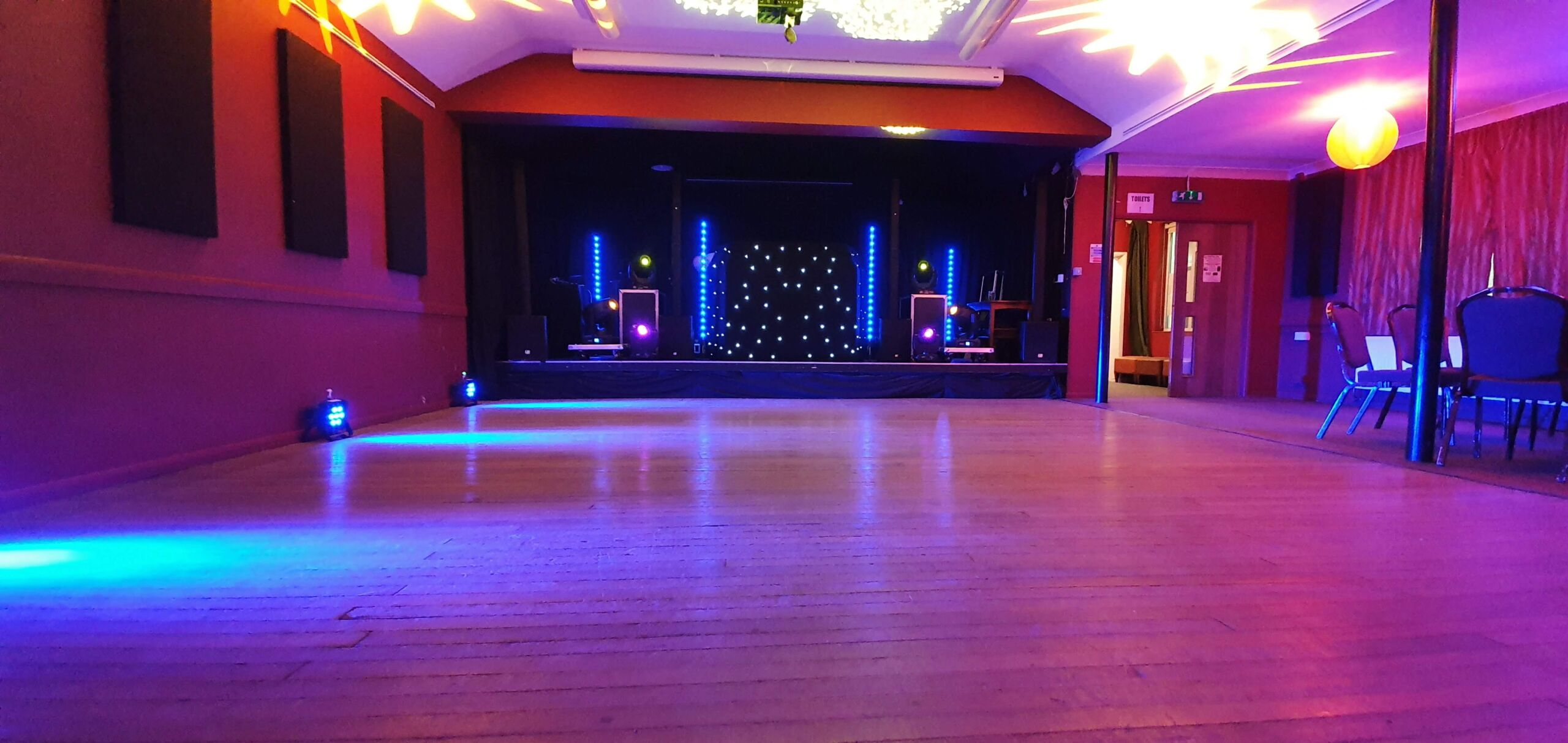 Mobile disco with starlit DJ booth and uplighting