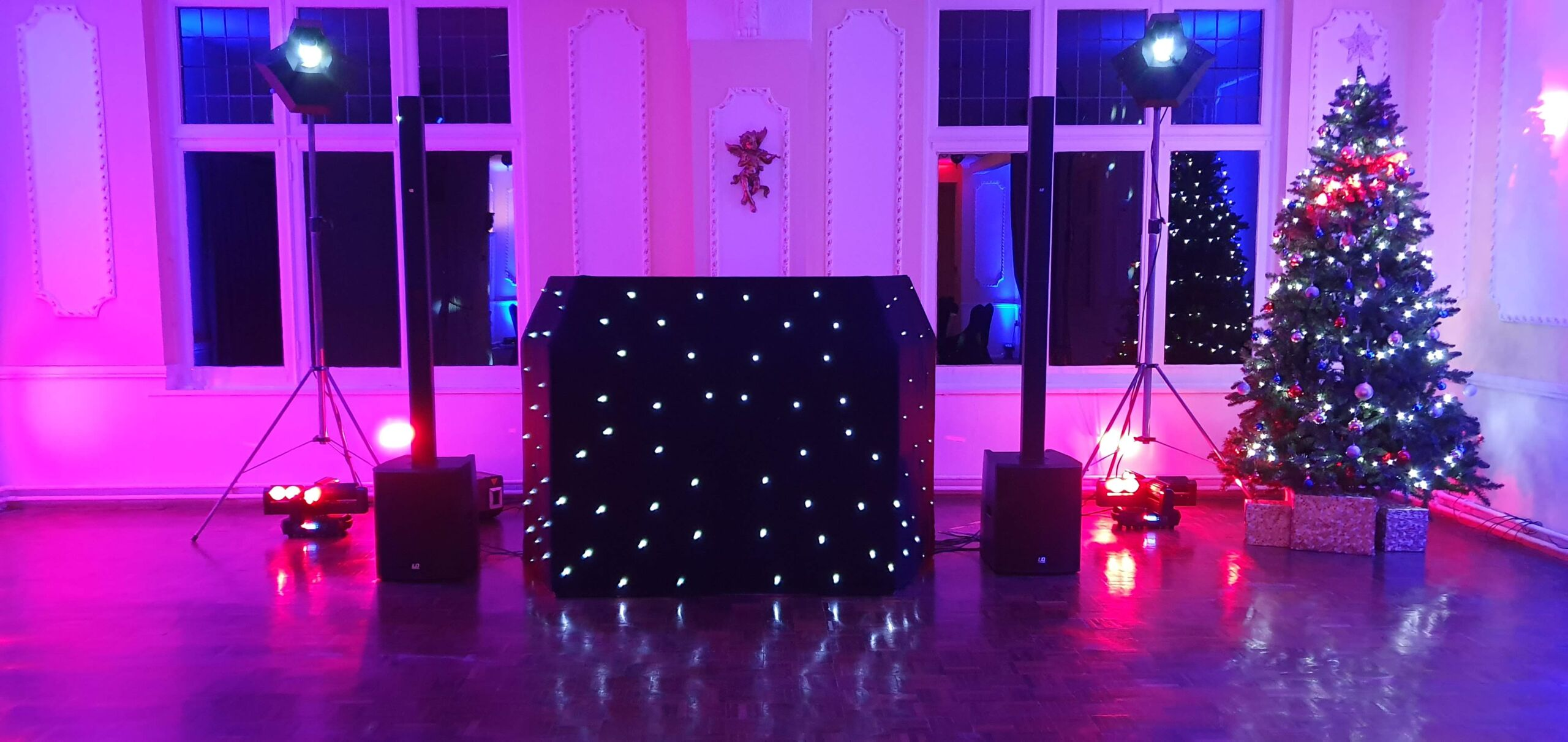 Mobile Disco for a Christmas Party with Christmas tree.